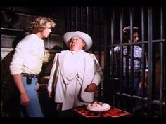 In Jail, Boss bribing Luke to fight in a boxing match or lose the farm.  And in this corner, Luke Duke s3-e4