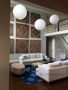 Quogue - Living Room Jen Going Interiors Madeline Wienrib, vintage window panels, earthy blue and neutral palette