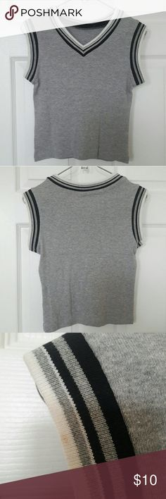 Grey Crop Top with Black/White Stripes Great condition. Small stain on sleeve. No tags but will fit a small.   Sleeve 6.5in Armpit to bottom 10in  Reasonable offers considered! Please refer to the chart in my shipping listing. If you go too low, I will simply decline.  PLEASE ASK as many questions before buying! I carefully pack my items so they are safe during transport/weather conditions. Tops Crop Tops