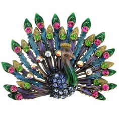 - This colorful brooch features a detailed peacock design adorned with colored plating and Swarovski crystals in shades of pink, green and blue. This pretty jewelry is fashioned of antiqued goldtone base metal and attaches with a classic pin. Peacock Jewelry, Peacock Art, Peacock Design, Green Peacock, Peacock Colors, Peacock Feathers, Peacock Pics, Feather Jewelry, Crystal Brooch