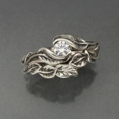 Delicate Leaf Engagement ring with matching Wedding Band.