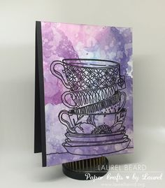 Watercolored teacup background with distress inks and stamps