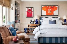 A custom-made bed anchors Declan's bedroom, which is clad in a wall covering by Elizabeth Dow; the bed linens are by Sferra.