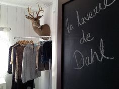 NEVER have seen a mounted deer in this pose....great laundry room icon...deer cleaning itself while you clean your clothes.
