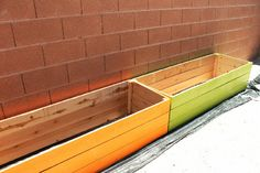 Raised Garden Beds painted the color of Carrots and Lettuce.