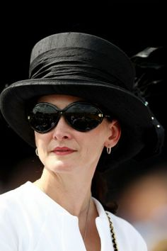 A fan wears a decorative hat prior to the 138th running of the Kentucky Derby.