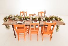 Protea Landscape Styled Shoot by Kadou Table Garland, Protea Flower, South African Weddings, Outdoor Furniture Sets, Outdoor Decor, Wood Table, Tablescapes, Wedding Styles, Orange Chairs