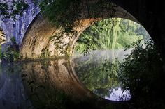 The beautiful structure of the bridge forms a circle with its watery reflection!