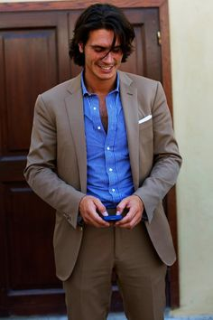 Brown suit and blue shirt