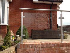 Framed stainless steel and glass balustrade system core drill and pocket fixed into brick wall. Balustrade Design, Steel Balustrade, Glass Balustrade, Glass Railing, Balcony Railing, Balcony Glass Design, Glass Balcony, Stainless Steel Railing, Brick Garden