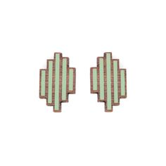 Turpentine Mara Stud Earrings in Pistachio Green: These Mara Stud Earrings are from the new Amies jewellery collection, designed in-house and exclusive to the Turpentine. Inspired by the timeless beauty of Art Deco the range incorporates elegant geometric designs and understated lines within precisely cut wooden pieces.  These contemporary earrings have been cut from 3mm walnut wood which is then finely etched to create the delicate lines. Every pair are carefully hand painted in our London…