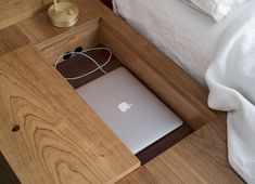 Asher Israel bed frame detail--a built-in laptop slot--in an apartment designed by Workstead, Matthew Williams photo | Remodeista