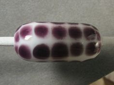 Black Currant on white - and the edges of the dots are soft and fuzzy.