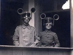 """""""This fascinating photograph shows a junior officer and NCO from an unidentified Feldartillerie regiment wearing combined acoustic/optical locating apparatus. This is puzzling because in Germany the anti-aircraft role was performed by the Air Service, not the artillery. The small-aperture goggles were apparently set so that when the sound was located by turning the head, the aircraft would be visible."""""""