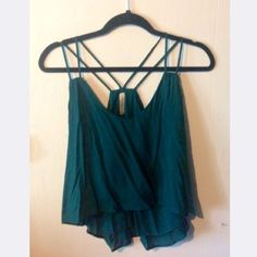 Cute Teal Tank Dark teal v-neck tank with double shoulder strap. Crop top in front, longer in back. Never worn. Final Touch Tops Tank Tops