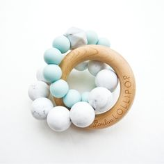 Loulou Lollipop Trinity Wood & Silicone Teether Robin's Egg Blue - The Trinity teething ring is a great teething toy for the curious little babies. It is easy to Baby Registry Items, Baby Items, Baby Shower Gifts, Baby Gifts, Spearmint Baby, Teething Toys, Teething Babies, Baby Teethers, Wood Rings