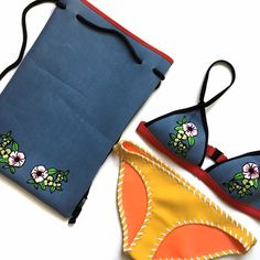 TRIANGL Blue Floral Appliqué Neoprene Backpack ❌NO TRADES❌  - Authentic TRIANGL brand Neoprene Backpack  - Denim Blue with Floral Appliqués Neoprene w/ Black Straps  - Neoprene  - Approx 16'' x 10''  - New, never used  - Swim Suit NOT INCLUDED/ NOT FOR SALE triangl swimwear Bags Backpacks