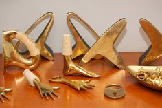 Foot cork stoppers, earlobe bookends, & more by Carl Auböck at Sigmar. . . from the story London's Global Galleries