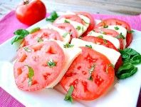 Mozzarella Caprese Salad on arugula and add fresh basil