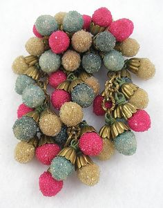 Early unsigned Miriam Haskell brooch, a Frank Hess design made with fuchsia, teal and champagne colored glass sugar beads