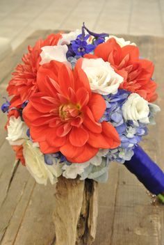 Red, Blue and white bridal bouquet with dahlias, lisianthus, delphinium, hydrangea, roses.