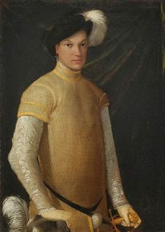Niccolo dell'Abbate (Italian, 1509/1512-1571) Mannerist Painter, School of Fontainebleau ~ Portrait of a young man wearing a plumed hat, a yellow doublet with slashed sleeves, lace cuffs and collar, resting his right hand on a plumed helmet.