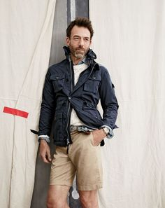 """J.Crew men's field mechanic jacket, cable cotton sweater, slim indigo Japanese chambray shirt, 9"""" stretch Stanton short, woven mountaineering belt and Mougin & Piquard™ chronovintage watch. To pre-order, call 800 261 7422 or email verypersonalstylist@jcrew.com."""