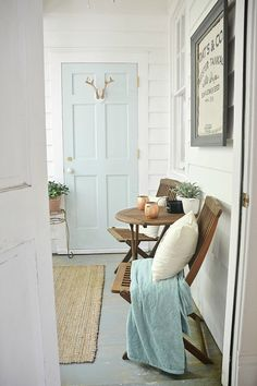 Sunroom makeover! Light, airy, & fresh! Hallway - turquise door