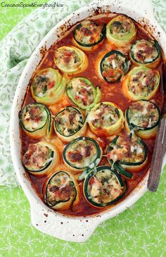 Thin slices of zucchini are stuffed and rolled up with a cheesy chicken and broccoli filling then baked in sauce until hot and bubbly.