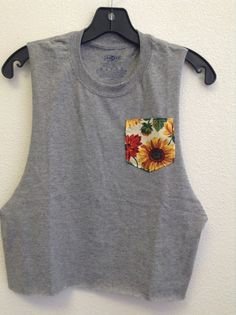 100% preshrunk cotton  Brand new and handmade.    Sunflower pocket crop muscle tank    T-shirts available    Youth sizes available