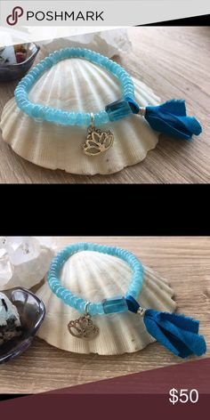 Aquamarine and Fluorite Mala Bracelet Aquamarine ro sells with a nugget of blue Fluorite. A blue sari silk handmade tassel with a Sterling silver lotus flower. All Sterling silver components. 7 1/4 inches in length. Jewelry Bracelets