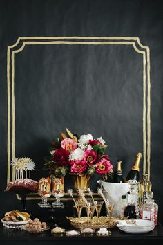 LOVE this party table and chalkboard wall backdrop