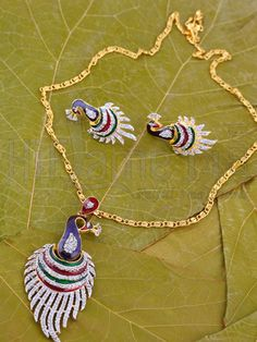 RENT : Peacock Design Pendant Set.  From the peacock collection, a elegantly crafted pendant decked with cubic zirconia stones and multi color enamel work. The matching cute peacock design earring adds an appealing look when matched for any ethnic or western wear.