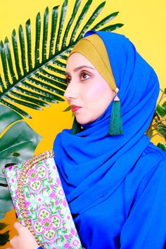 Blue Hijab on top of a mustard green inner. Clutches that has turquoise and magenta tone. Modesty with Confidence tapped with Earrings and Makeup. Blue Fashion, Modest Fashion, Stylish Hijab, Modest Wear, Industrial Style, Magenta, Clutches, Mustard, Confidence
