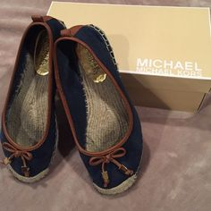 Micheal Korrs Meg Espadrilles Navy and Brown MK espadrilles, Meg style. Super comfortable. See picture three otherwise in excellent condition. Comes with box. Will fit an 8.5 make an offer everything in my closet is negotiable MICHAEL Michael Kors Shoes Espadrilles