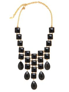 Channel the dark glamour of Cleopatra with this stunning statement necklace crafted from gold chain links and a glorious cascade of onyx gemstones in tile and teardrop shapes.