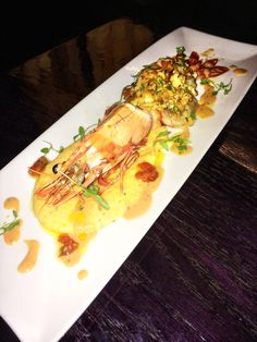 Crab Stuffed Jumbo Prawn served with Cheese Grits and a Tarragon Butter Sauce