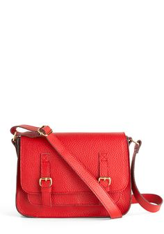 """Because You Can Bag  $64.99    This vegan faux leather cherry red mini-satchel makes you the queen of """"just because,"""" as its metallic cheetah print sides and leopard lining add an extra element of luxury to your look"""