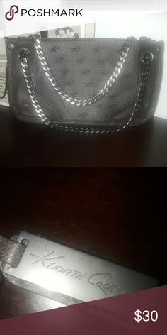 Kenneth Cole Small Handbag Super cute 💜 Chain handles. Top zipper with KC tag as pictured. Small flat bag. Used gently in EUC. Kenneth Cole Bags