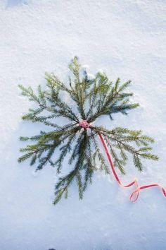 Gör en julstjärna av granris.