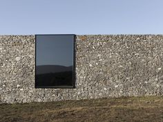 Australian studio designed D'Entrecasteaux House with protective stone walls and a dark timber interior, creating the perfect minimalist stone house refuge on the remote Bruny island. Facade Architecture, Contemporary Architecture, Australian Architecture, Computer Architecture, Architecture Today, Landscape Architecture, Bruny Island, Stone Facade, Stone Houses
