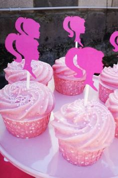 If cupcakes are more your thing then you won't want to miss these. Simply top some pink frosted cupcakes with some wonderful cutout Barbie silhouettes and you're good to go. See more party ideas and share yours at CatchMyparty.com #catchmyparty #partyideas #barbie #barbieparty #barbiepartyideas #teenparty #girlbirthdayparty