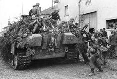 Nazis climb onto the back of a German Panzer tank