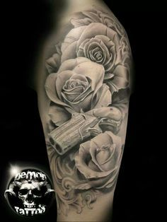 Black and gray roses and gun tattoo