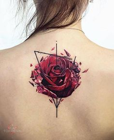 Graphic red rose tattoo on the upper back.