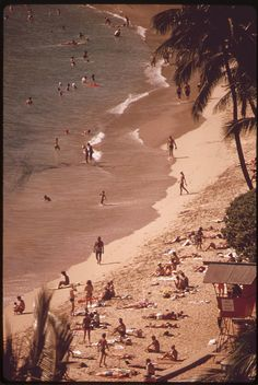 Waikiki Beach is the most popular tourist spot on the island there are 26,000 hotel rooms on Oahu. Most of them are in the Waikiki Beach area, October 1973 by The U.S. National Archives, via Flickr