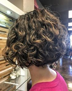 This is a short, layered, naturally and curly bob