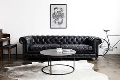 Leather sofa and cow skin rug