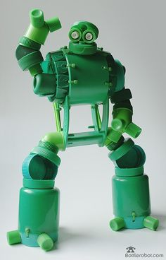 Soo freakin' cool!  I wonder how long I would have to save bottle parts to build one of these robots.