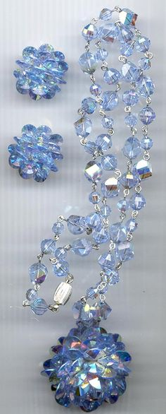 This dazzling necklace and earring set is signed Vendome. A high-end subsidiary of Coro, the Vendome line was made from 1944 to succeeding Corocraft. Artisan Jewelry, Antique Jewelry, Vintage Jewelry, Handmade Jewelry, Vintage Brooches, Crystal Pendant, Crystal Necklace, Crystal Beads, Swarovski Crystals